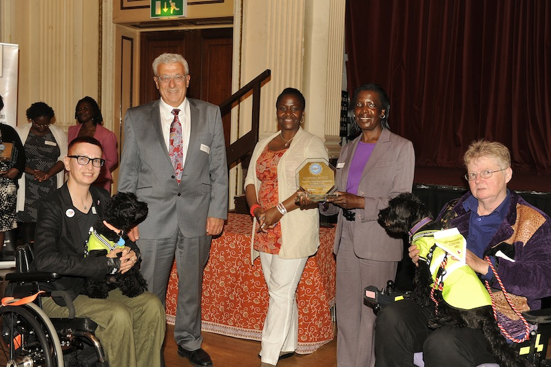 (Left to right) Artistic Director Ju Gosling (with Jazz), CCG Chair Dr Zuhair Zarifa, Communities of Health Coordinator Saundra Daniels, Operations Director Georgia Drysdale and Company Chair Julie Newman (with Precious) at the Communities of Health awards ceremony during the launch of Newham CCG at West Ham Town Hall on 11 July 2013.