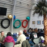 Colour photograph of the exhibition in the cafe area of the Hub.