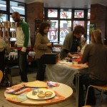 Colour photography showing book stall and art activity
