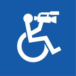 graphic of a wheelchair user holding a camcorder
