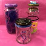 Colour photograph of decorated glass jars