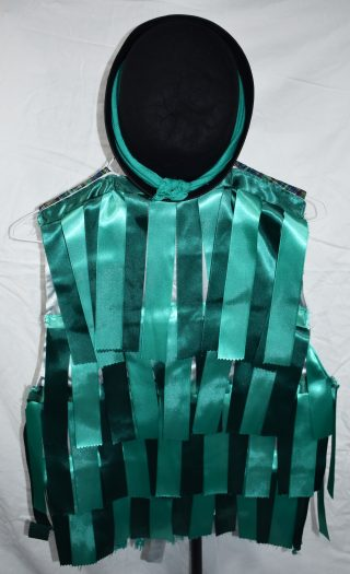 The back of the waistcoat, covered in dark and light aqua satin ribbons