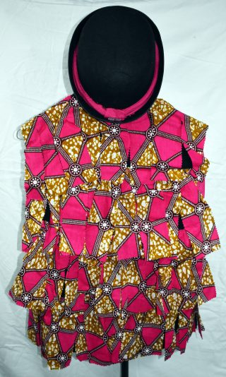 Photograph of the back of the waistcoat, covered in pink African fabric tatters