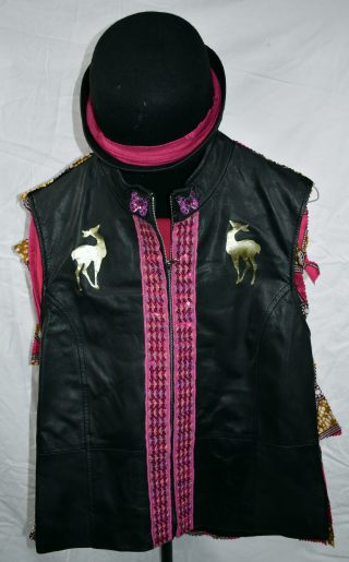 Black leather-fronted waistcoat with gold deer on either shoulder and pink butterflies appliquéd at the top of the zip, and pink braid on the sides