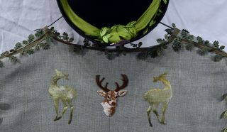 Detail of back of waistcoat, with appliqué gold deers and a stag's head