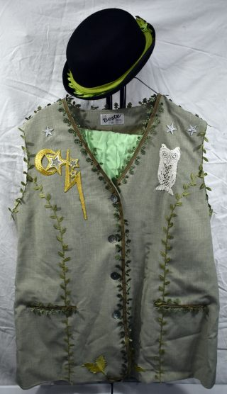 Light green men's waistcoat, up cycled with green leaf trim, silver and gold appliqué stars, and an appliqué lace owl