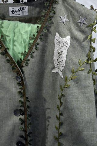 Close up of appliqué lace owl