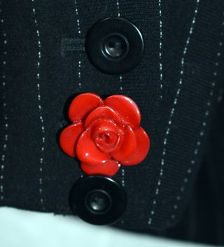 close up of rose button on cuff