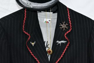 Close up of badges and necklace