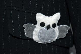 Close up of felt owl badge on pocket