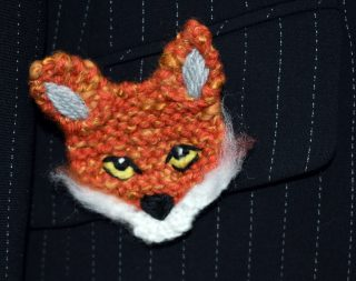 Close up of knitted fox badge on pocket