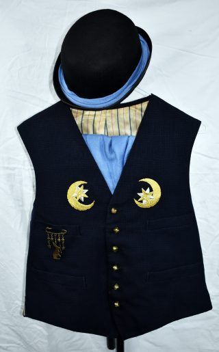 Dark blue and black suit waistcoat, with the buttons replaced by gold bells, gold moons appliquéd on the breasts and a brass pin with hares and stars on one pocket