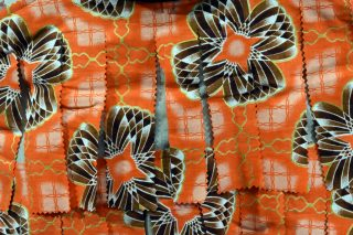 Close up of orange tatters