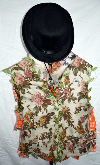 Orange, white and pink floral waistcoat, with green leaf trim and hare and button badges