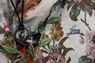Close up of hare badge and necklace