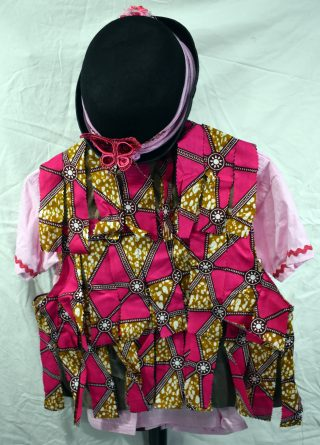 Back of waistcoat, covered in pink African fabric tatters