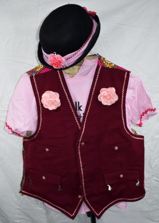 Dark pink woollen waistcoat with pale pink braiding, pink roses and silver hares hanging from the pockets