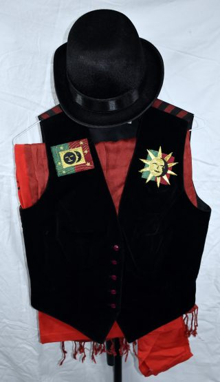 Black velvet waistcoat with red and black striped satin back, with red, green cold and black star and moon appliqués on the breasts