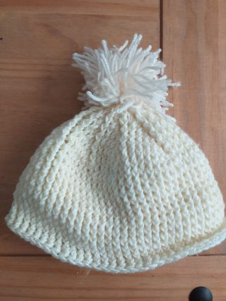 White knitted hat with pom pom