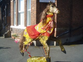 Photograph of the horse puppet in the street