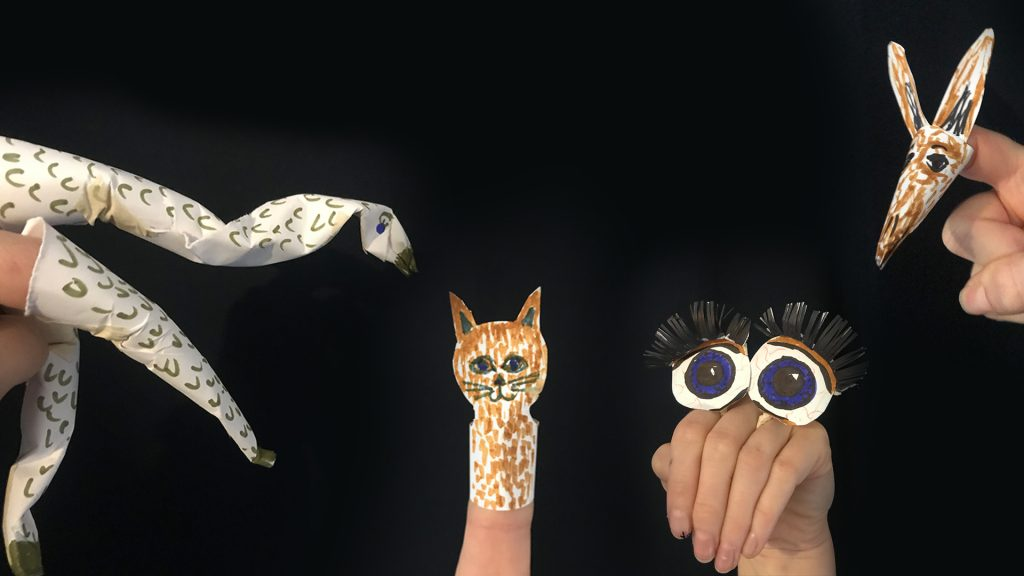 Photo of hands made into puppets.