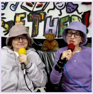 Ju and Julie on the show, in lavender coloured tops and bucket hats